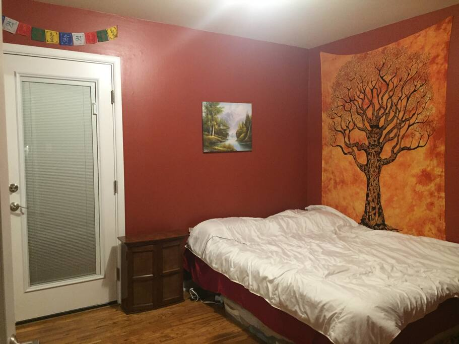 Guest bedroom. Door to our private backyard. There is also a window in the room, plenty of sunlight!