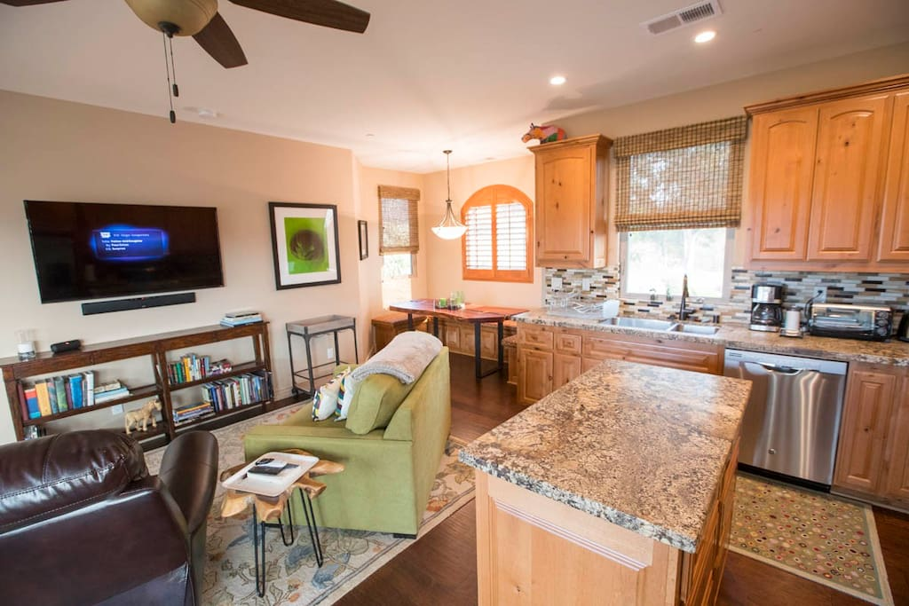 Living area with Twin sofa-bed, full sized kitchen and dining table nook.