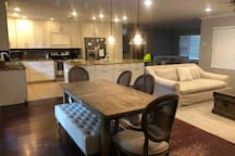 Family friendly OPEN floor plan! Great for hosting family gatherings or for being able to keep an eye on all the kiddos!  Main living area includes kitchen with large island, living room with tv, and 2 farmhouse style dining areas.
