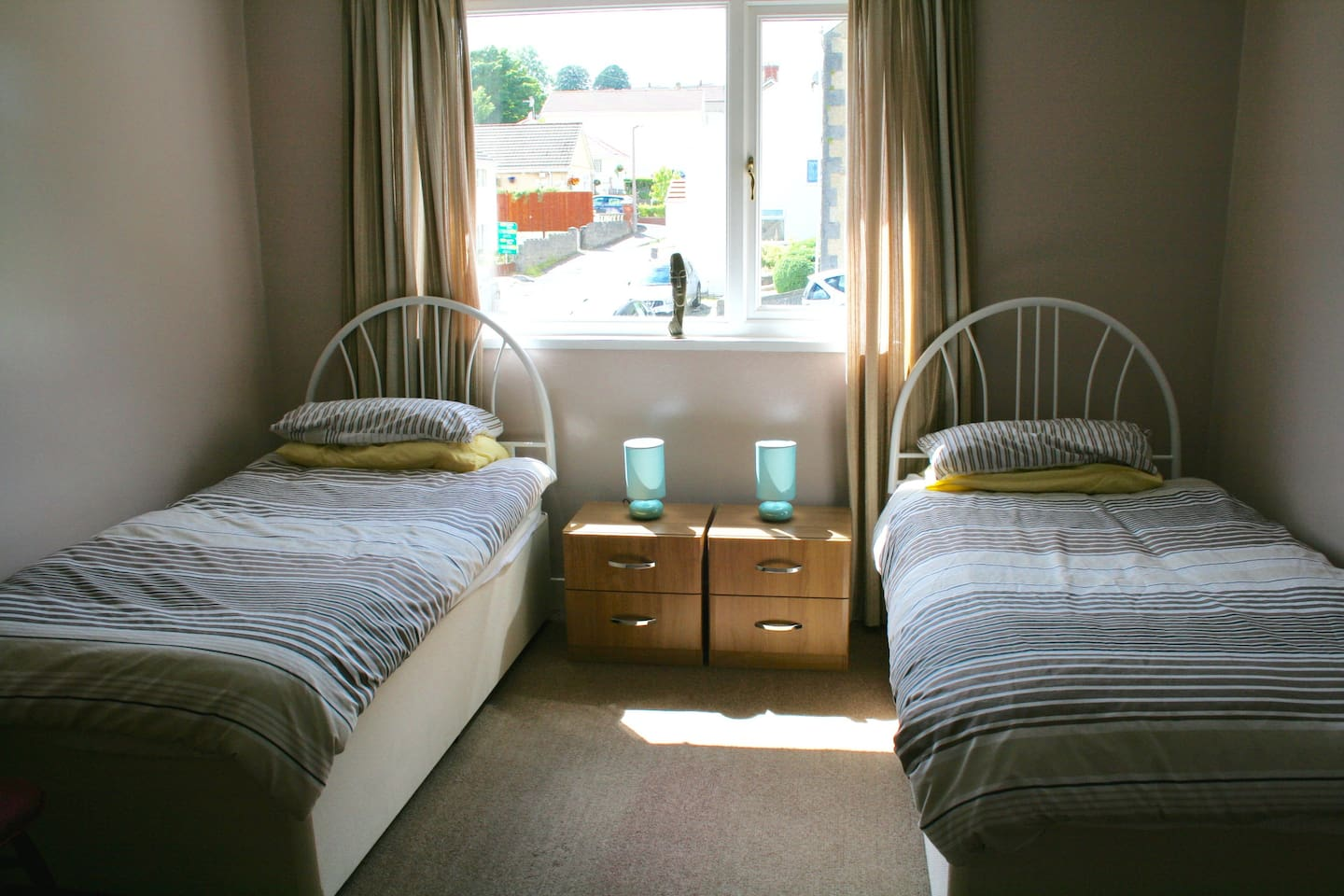 Large twin bedroom with new beds, large chest of drawers, two chairs and clothes rack.  Very quiet for a good nights sleep.
