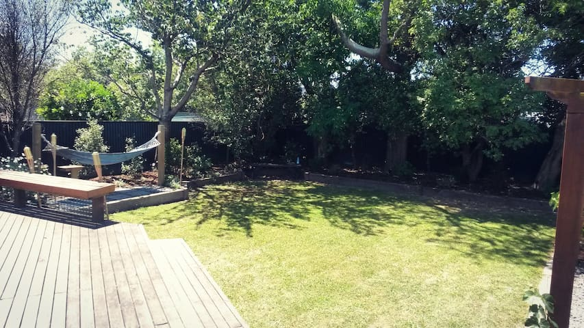 Sun soaked deck, one guest bedroom, central suburb