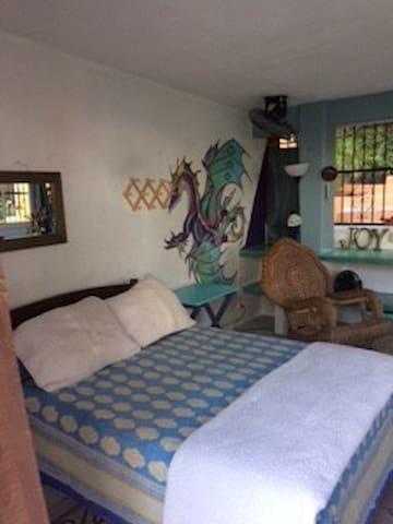 Inside the is one double bed, wicker rocker