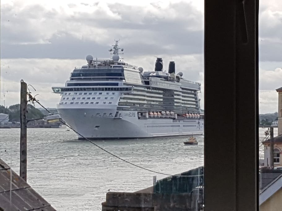 view from Kitchen window, the cruise liner heading off