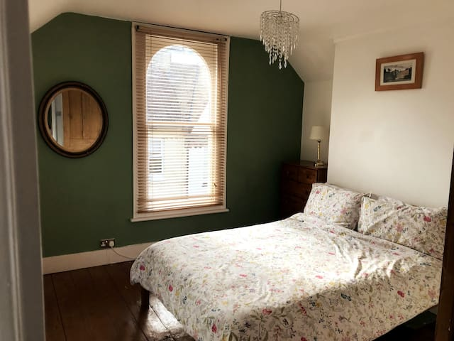 Double room at the top of an elegant town house.