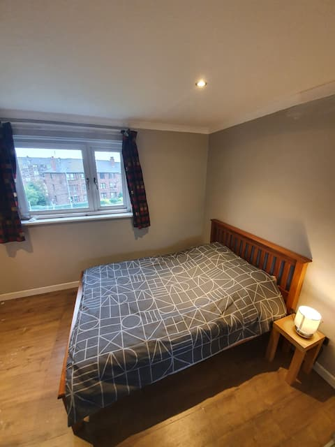 Open plan studio flat with double bed and sofa bed