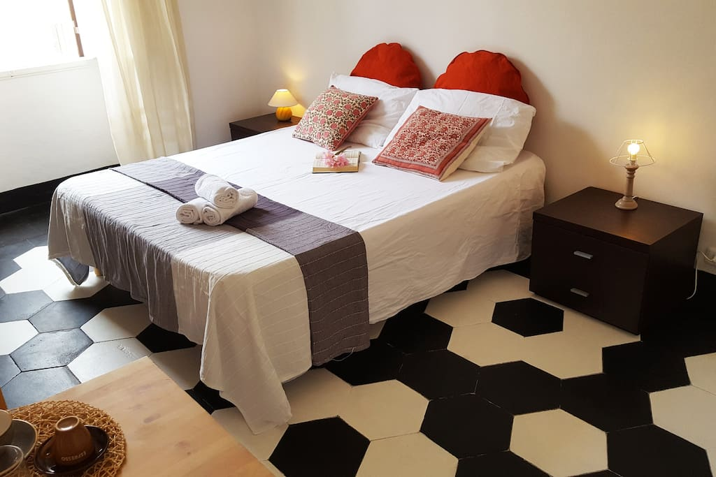 Cozy luxury room with a double bed, vintage roman style