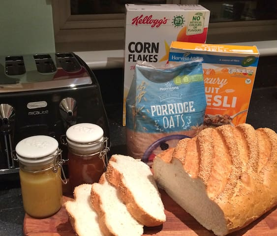 Continental breakfast of Bread, Toast, Jams and Cereals served in kitchen/dinner