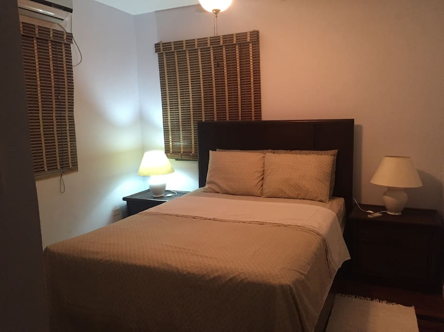 Bedroom with A/C and comfortable queen bed.