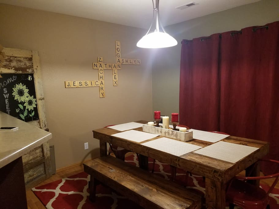 Dining area with table. Sits up to 7. Sliding glass door leads to huge backyard with outside entertaining.