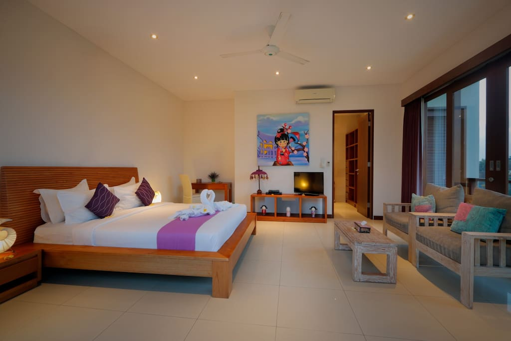 Spacious bedroom with a comfortable seating area