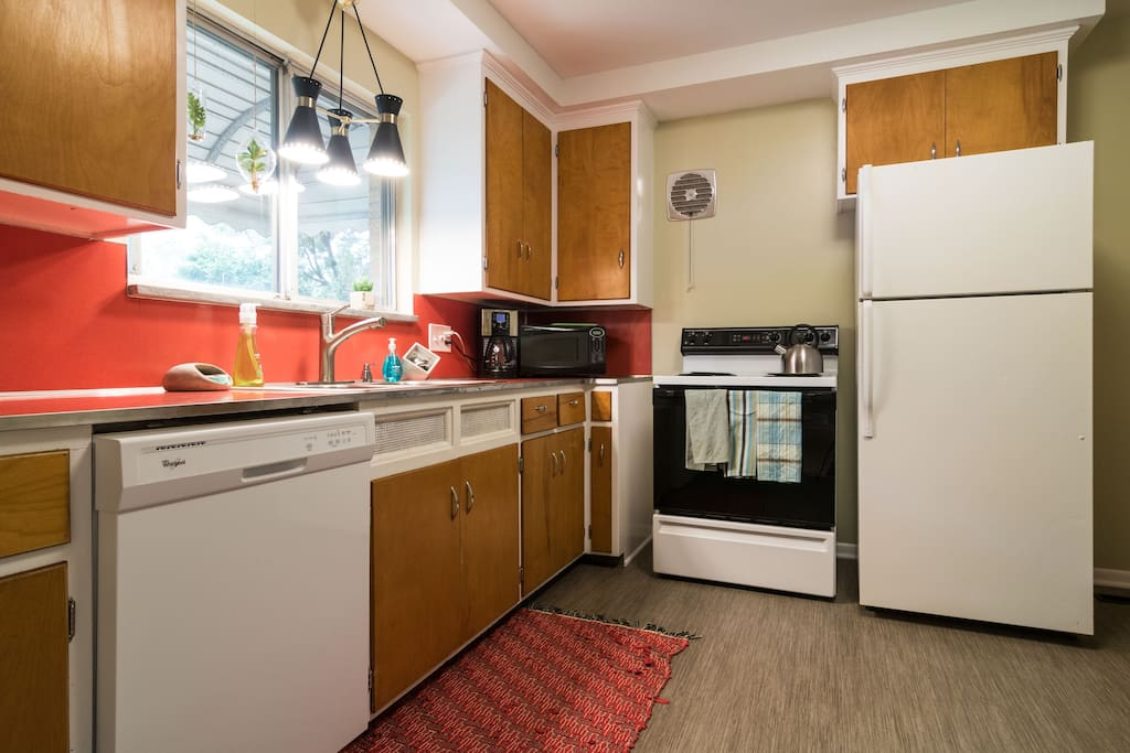 Vintage kitchen with updated amenities and appliances.