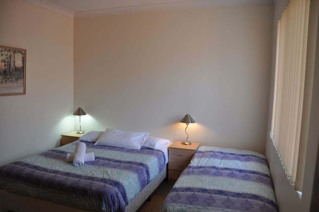 Bedroom 1 with queen and single beds