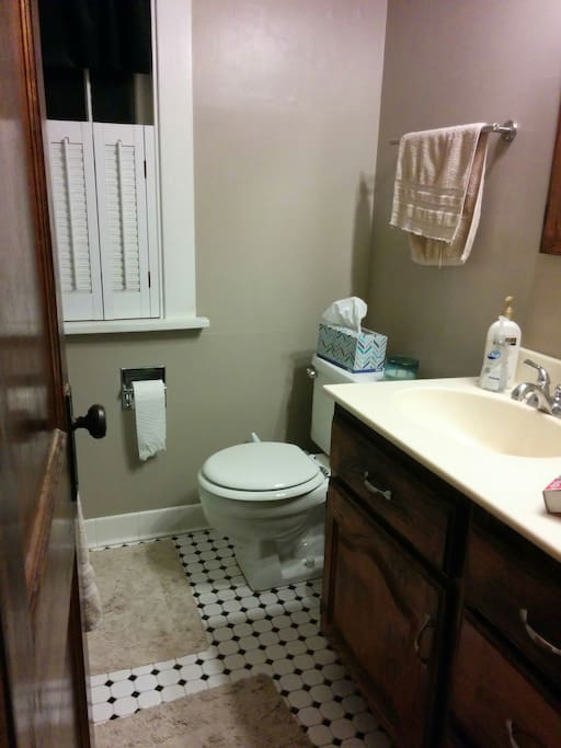 Shared bathroom with tub/shower combination second floor