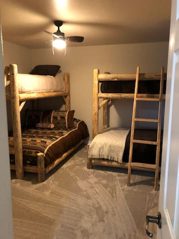 Two bunk beds with full size mattress on bottom and twin size on top.