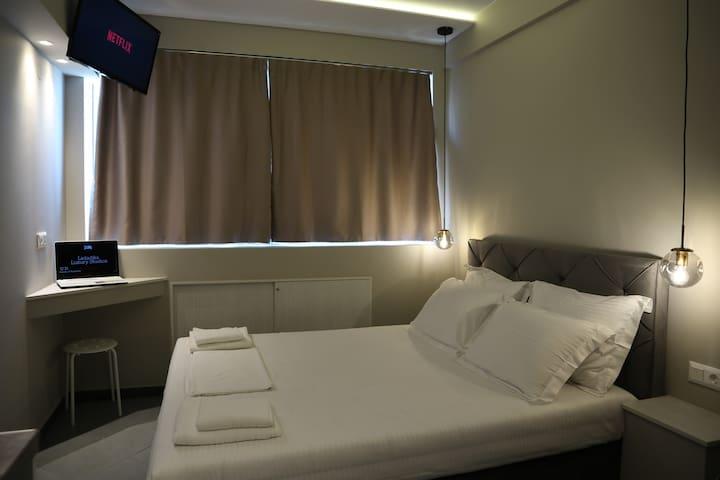 bedroom with king size bed, smart tv(netflix) desk for pc