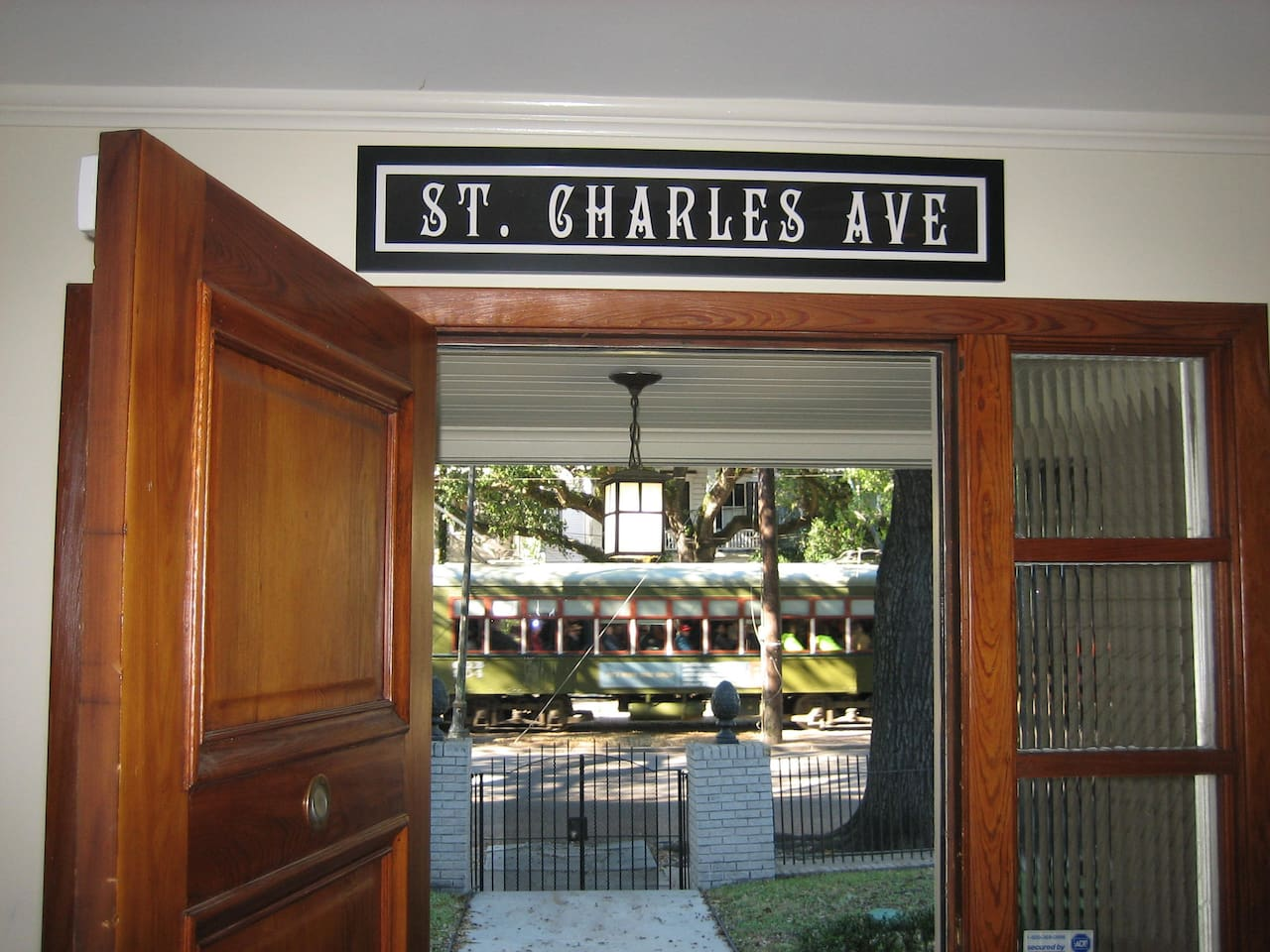 World Famous St. Charles Ave. Street car passes in front
