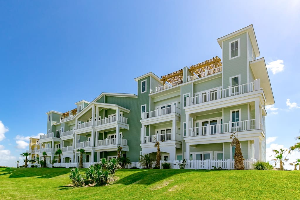 Your four-story townhouse overlooks the marina