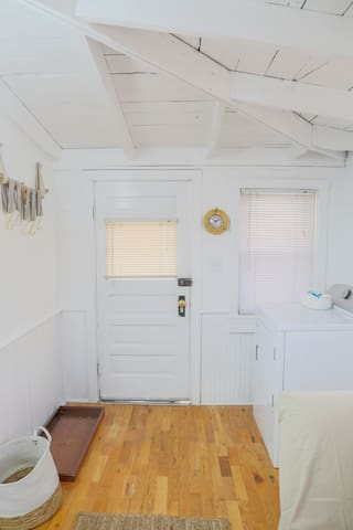 A look back at the door that leads into the sun room. Easy access to a new dryer.