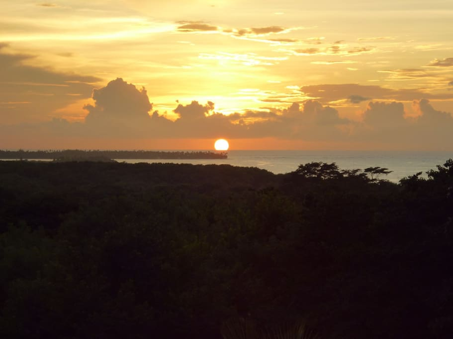 View of the sunset from the deck overlooking buccoo reef and the nylon pool