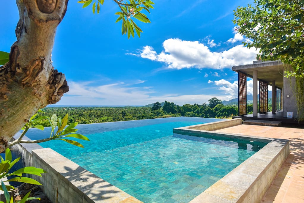 Infinity pool with sea and mountain views