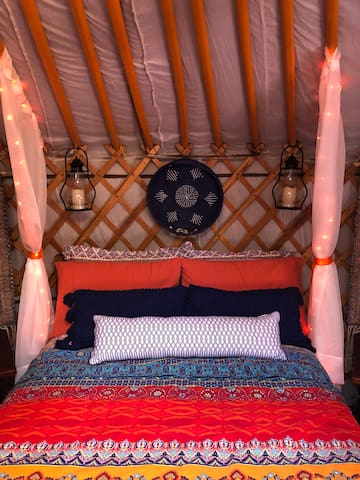 Soft, warm lighting provides a romantic ambience throughout the yurt.