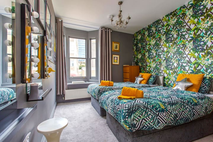 Bedroom 1. Big and airy, and with an en-suite toilet and shower. The beds can be made up for you as either 2 singles or 1 superking bed.