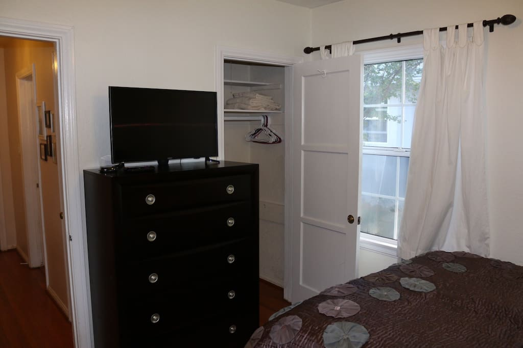 "32"" LCD Samsung TV with Roku, dresser, and closet of your room."