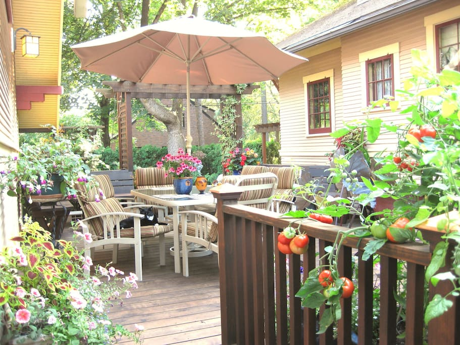 Flower filled deck leads to your private entrance.
