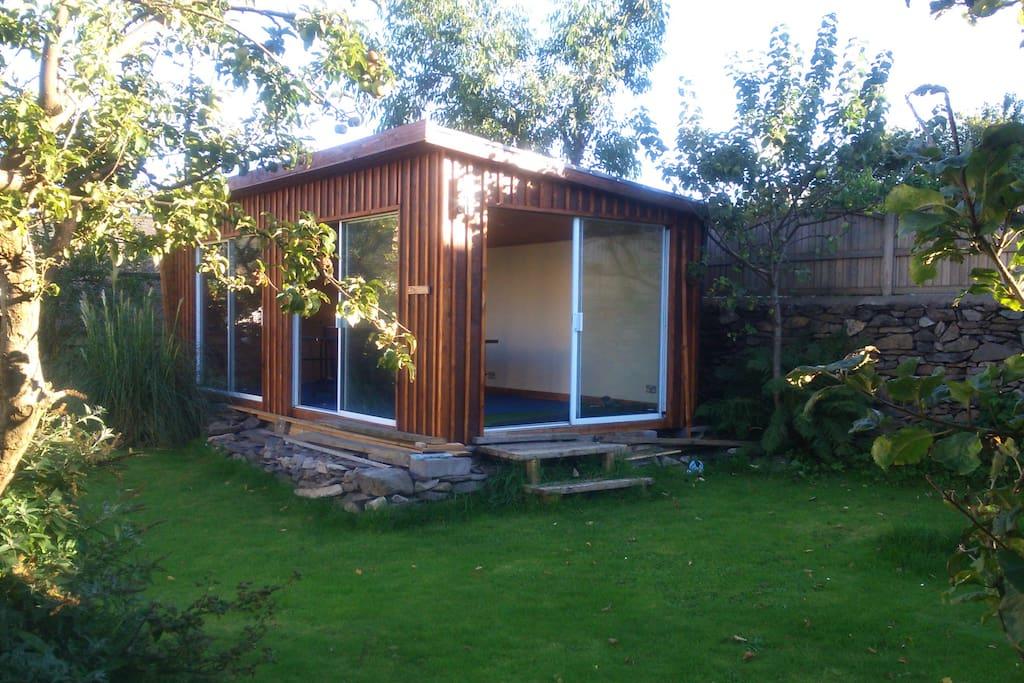 Garden Cabin with Table tennis and trampoline in garden