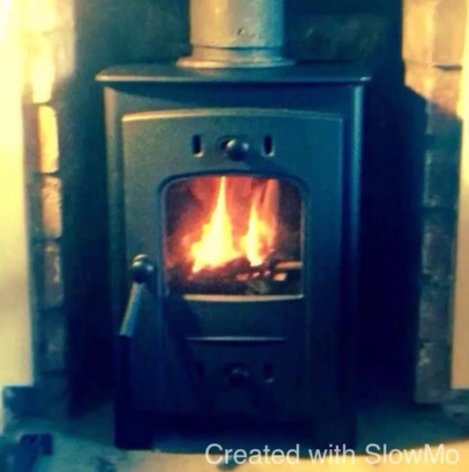 A cozy solid fuel burner stocked for your stay.