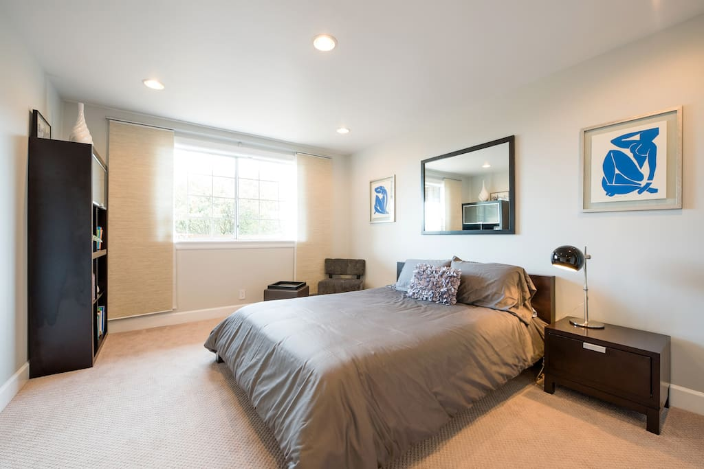 Spacious and sunny bedroom with fine linens