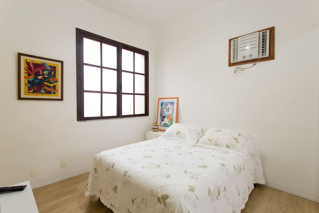 Double bedroom with AC, wardrobe, fan and TV