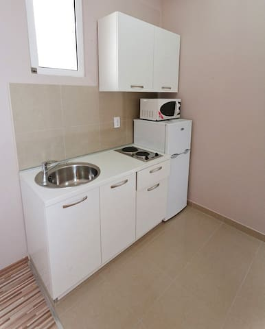 Functional kitchen - stovetop, fridge and microwave.