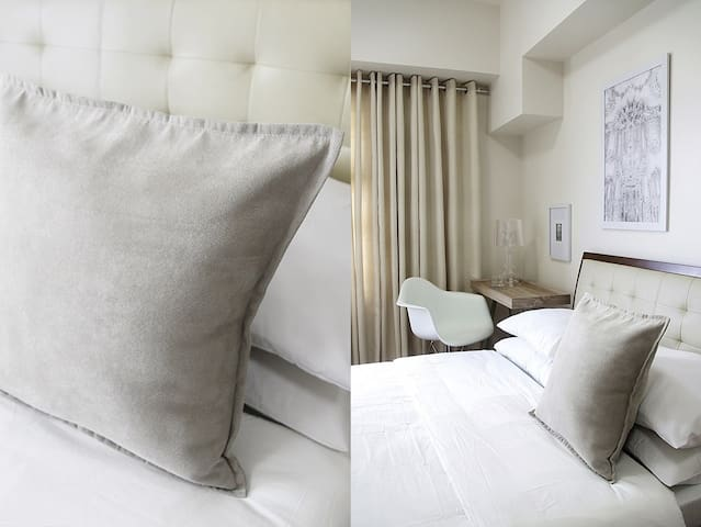 Comfortable queen size Uratex foam bed with tufted leather headboard. A single size Mandaue foam floor full mattress is provided for the extra Guest.