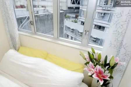This 2BR flatshare is minutes to central and a million hidden gems in HKG. I'm away so it's available for travelers and business professionals alike!  If you're an adventure traveler, foodie, young professional or explorer, you'll love this area