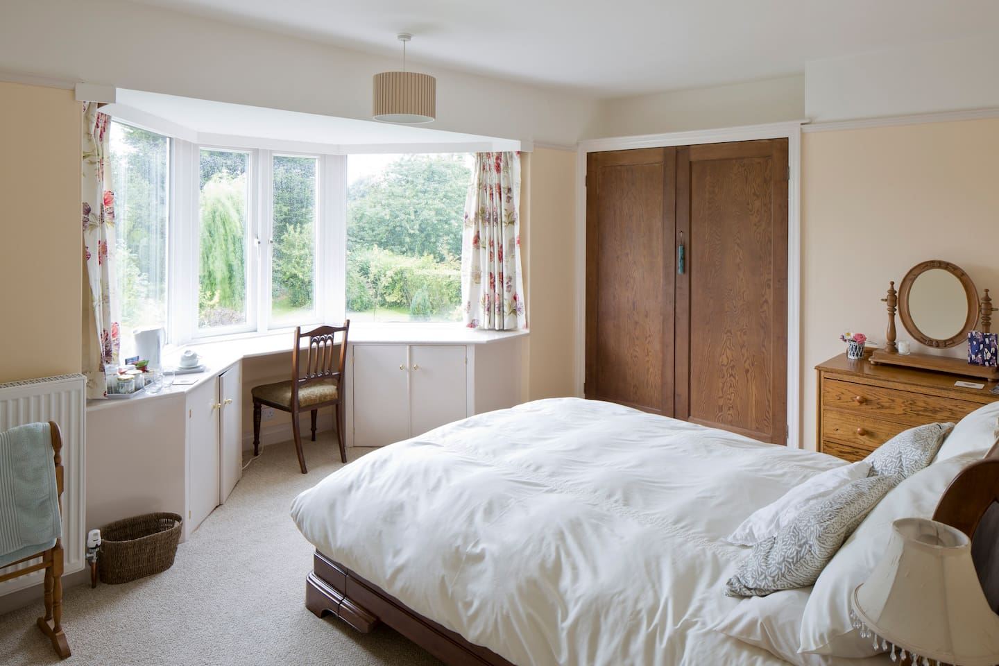 your airy bedroom with garden views and King Size bed