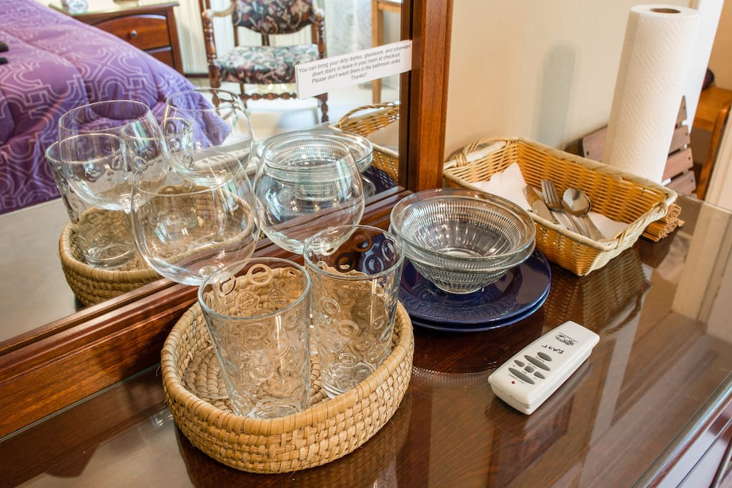 Our rooms have  basic dishware for your convenience, and we also provide you with a pitcher of filtered water.
