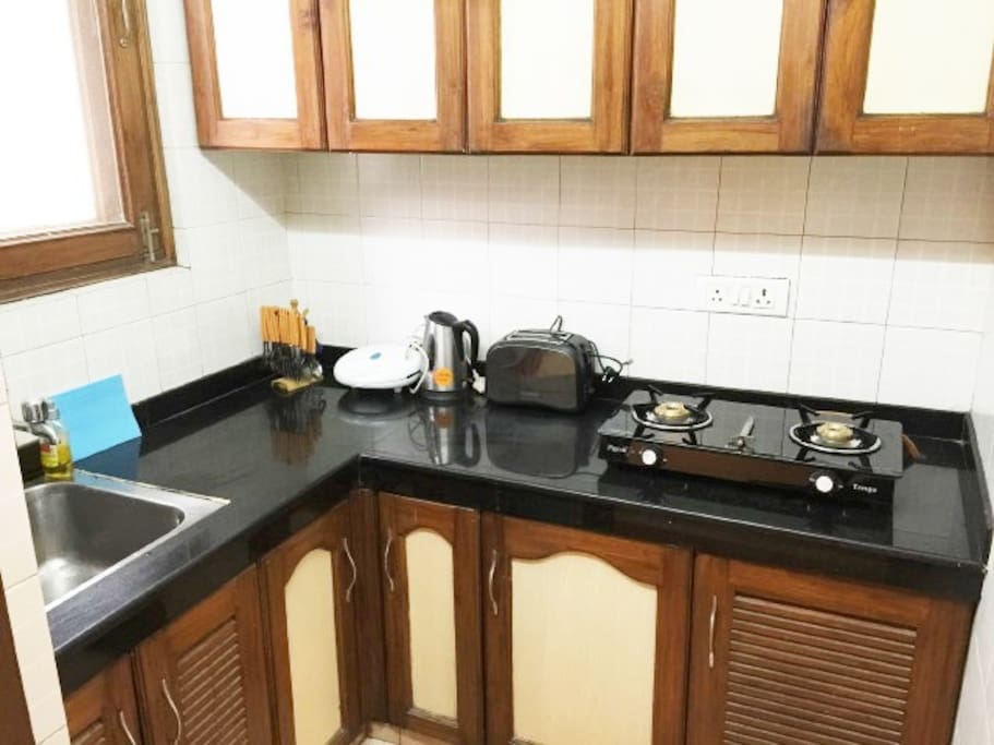 Fully loaded Kitchen with Stovetop Gas, Refrigerator, Microwave, Toaster, Electric Kettle and all cutlery/crockery