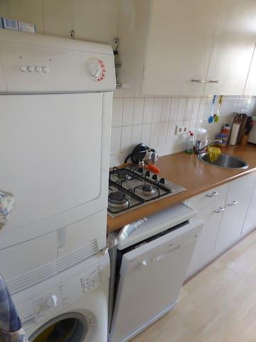 Kitchen with dishwasher, washing machine and dryer