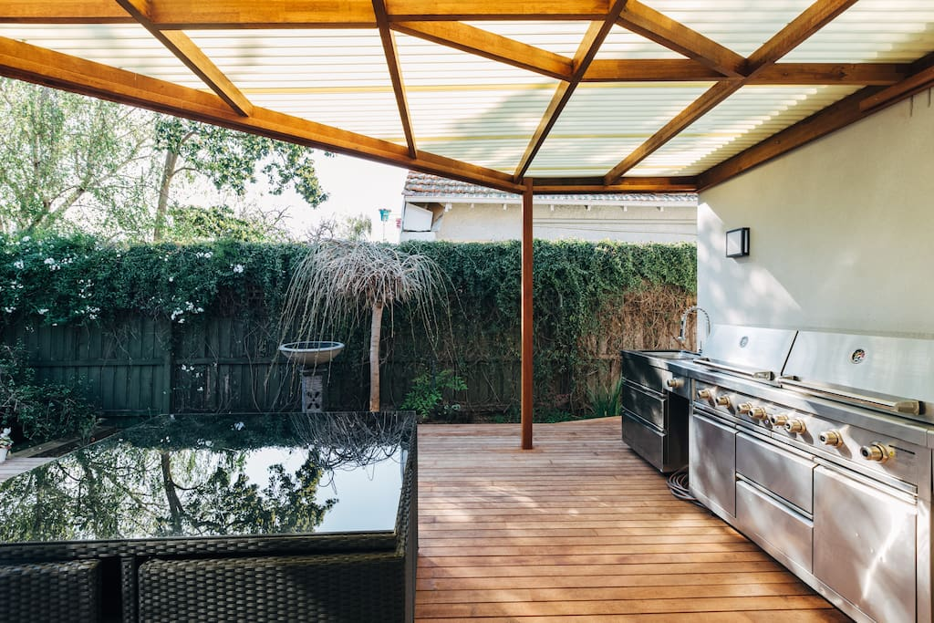 Inviting Outdoor Setting with 6 Burner BBQ and Mini-Golf!