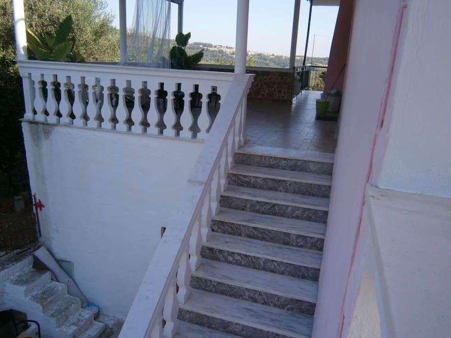 Up the stairs to the veranda and the entrance on the right