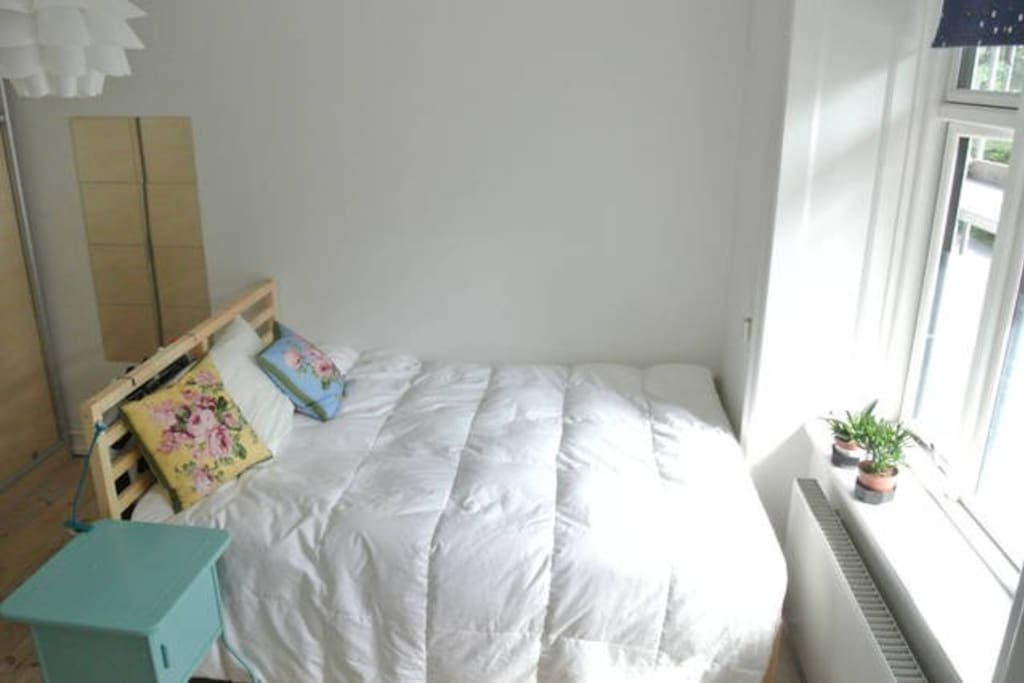 Bedroom with double bed.  Very sunny.