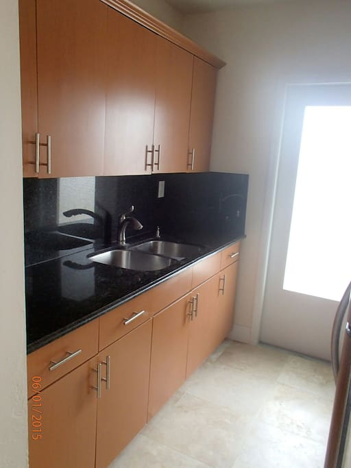 Full kitchen with double sinks and granite counter tops