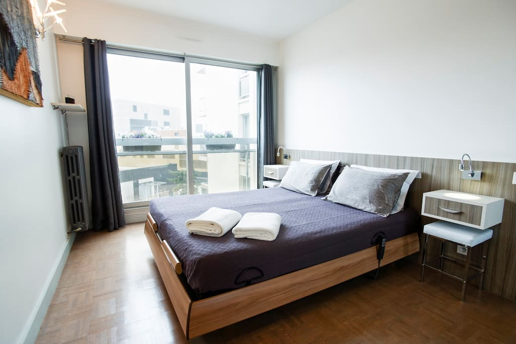 Ergonomic double bed in the air conditioned master bedroom with electric controls for headrest and lumbar support