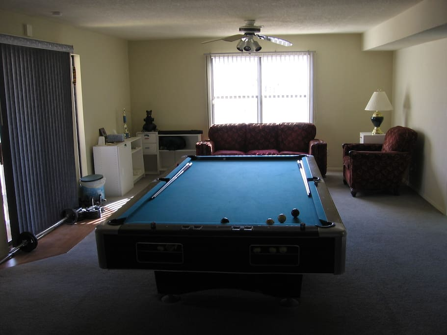 Great room with pool table, stereo disc player and sitting area
