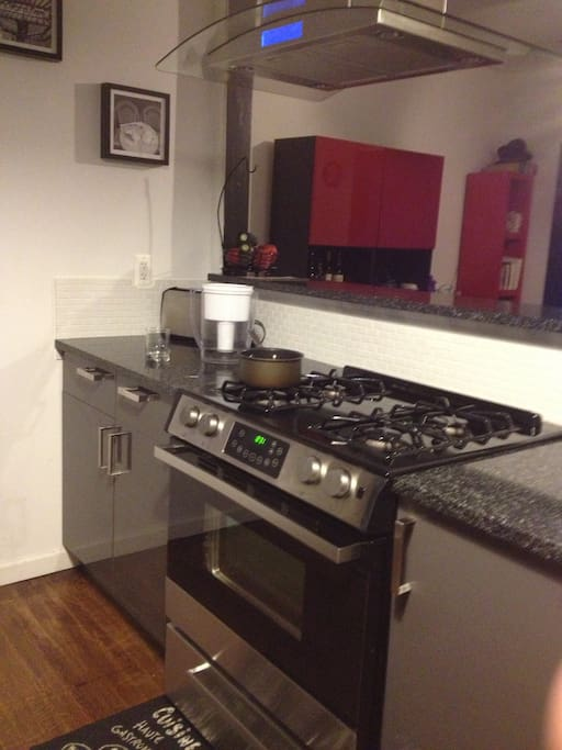 Open kitchen, oven, and fully stocked kitchen appliances