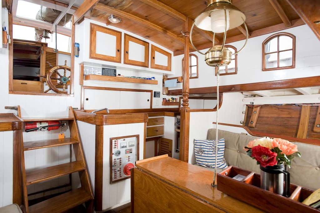 Tall folks love the headroom in the galley.  Seats 6.  Pilot berth available.