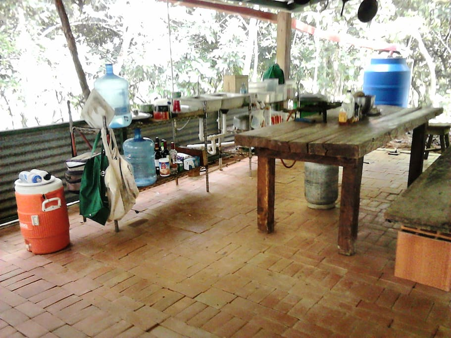 Alex's Place, Miramar, Panama. Open social areas in house. Kitchen.