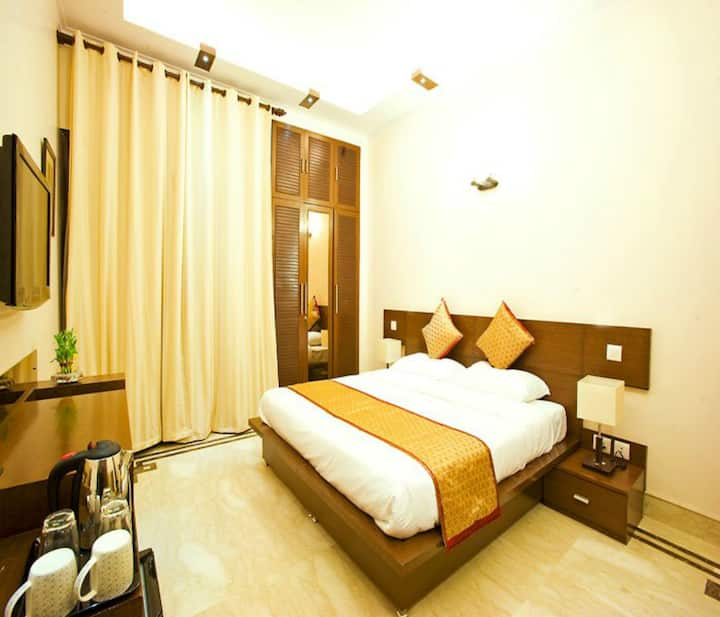 Luxury King Room Defence Colony