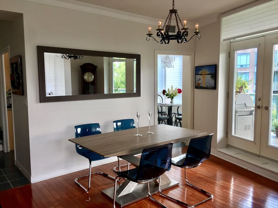 Modern dining area with seating for 8 while you look out windows with a 270 degree view